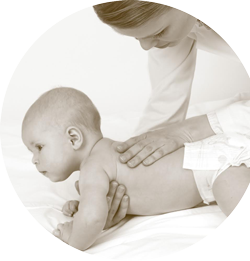 Pregnancy massage therapist massaging baby in Lee's Summit, MO